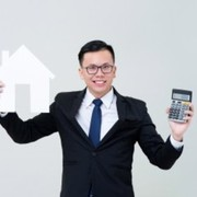 Asian man agent showing house model with calculator 8087 2832 small